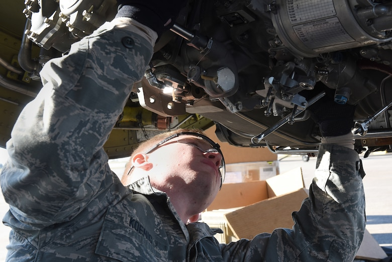 U.S. Air Force Airmen Zachary Koenig, 22nd Expeditionary Aircraft Maintenance Unit KC-135 Stratotanker jet engine mechanic, takes apart a KC-135 engine at Incirlik Air Base, Turkey, Nov. 15, 2018.