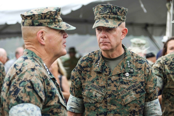 Commandant of the Marine Corps Gen. Robert B. Neller, left, speaks to Lt. Gen. David H. Berger