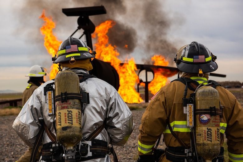 Firefighters from the 56th Civil Engineer Squadron and Gila Bend Air Force Auxiliary Field, prepare to participate in a joint aircraft and structural live fire training, Nov. 14, 2018 at Luke Air Force Base, Ariz.