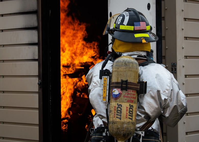 A Gila Bend Air Force Auxiliary Field firefighter holds a door open during a joint aircraft and structural fire training, Nov. 14, 2018 at Luke Air Force Base, Ariz.
