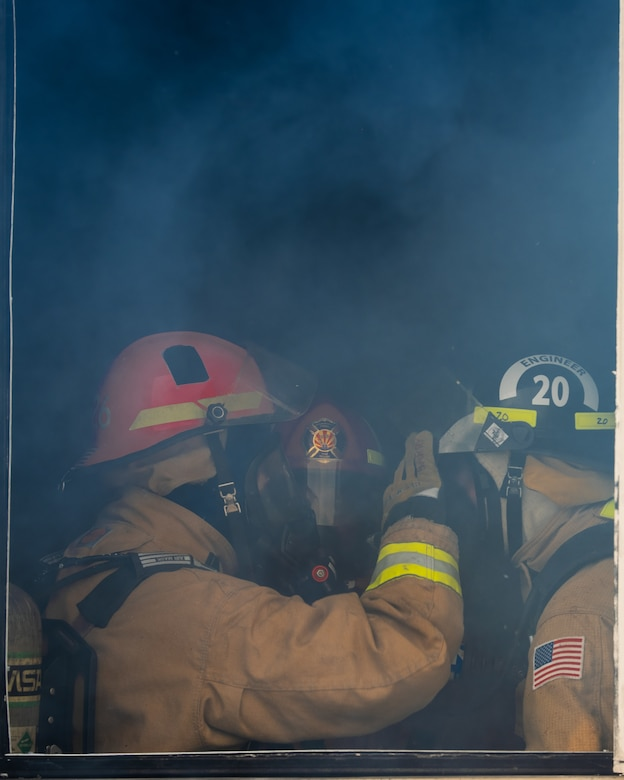 56th Civil Engineer Squadron firefighters perform gear checks next to an open window during a joint aircraft and structural fire training, Nov. 14, 2018 at Luke Air Force Base, Ariz.