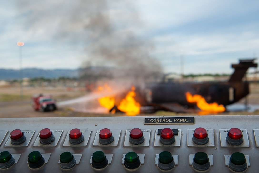 Firefighters assigned to the 56th Civil Engineer Squadron try to extinguish a training fuselage fire during a joint aircraft and structural live fire training, Nov. 14, 2018 at Luke Air Force Base, Ariz.