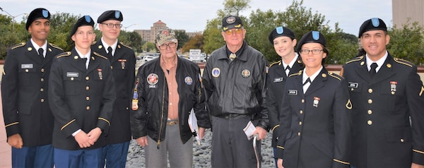 John Smelik (center, left), a retired U.S. Marine, and son-in-law Travis Briggs (center, right), retired Air Force, have hosted Soldiers for Mission Thanksgiving for the last 17 years.