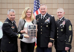 Lt. Gen. Todd T. Semonite, left, and Command Sgt. Maj. Bradley J. Houston, far right, present Huntsville Center's Office of Small Business Initiatives Chief Rebecca Goodsell and Huntsville Center Commander Col. John S. Hurley with one of several awards and recognitions during the recent 2018 Society of American Military Engineers Small Business Conference in New Orleans.