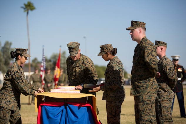U.S. Marine Corps Col. David A. Suggs, commanding officer, Marine Corps Air Station Yuma, cuts the cake during the 243rd Marine Corps birthday uniform pageant at the Parade Deck on Marine Corps Air Station Yuma, Ariz., Nov. 8, 2018. The annual ceremony was held in honor of the 243rd Marine Corps birthday, showcasing historical uniforms to honor Marines of the past, present and future while signifying the passing of traditions from one generation to the next. (U.S. Marine Corps photo by Sgt. Allison Lotz)