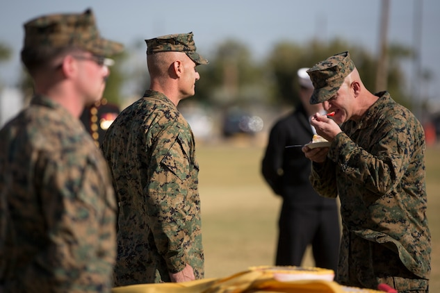 U.S. Marine Corps Sgt. Maj. David M. Leikwold, sergeant major, Marine Corps Air Station Yuma, takes the first bite of cake while participating in the 243rd Marine Corps birthday uniform pageant at the Parade Deck on Marine Corps Air Station Yuma, Ariz., Nov. 8, 2018. The annual ceremony was held in honor of the 243rd Marine Corps birthday, showcasing historical uniforms to honor Marines of the past, present and future while signifying the passing of traditions from one generation to the next. (U.S. Marine Corps photo by Sgt. Allison Lotz)
