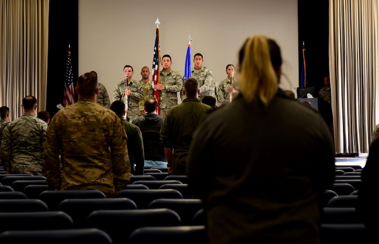 799th Security Forces Squadron Airmen perform the national anthem for 799th SFS Military Working Dog, Kiara's, retirement ceremony at Creech Air Force Base, Nevada, Nov. 15, 2018. MWDs work with their handlers to detect threats and defend against any and all adversaries. (U.S. Air Force photo by Airman 1st Class Haley Stevens)