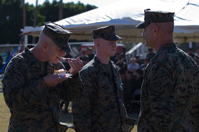 U.S. Marine Corps SgtMaj. David M. Leikwold, sergeant major, Marine Corps Air Station Yuma, eats a piece of birthday cake during the 243rd Marine Corps birthday uniform pageant at the Parade Deck on Marine Corps Air Station Yuma, Ariz., Nov. 8, 2018. The annual ceremony was held in honor of the 243rd Marine Corps birthday, showcasing historical uniforms to honor Marines of the past, present and future while signifying the passing of traditions from one generation to the next. (U.S. Marine Corps photo by Lance Cpl. Joel Soriano)