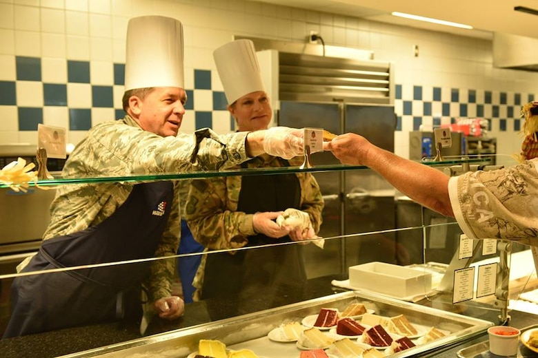 Col. Donald Shannon, 45th Weather Squadron commander, and Maj. Dawn Baker, 45th Launch Readiness Squadron commander, serve a Thanksgiving meal at Patrick Air Force Base Riverside Dining Facility on Nov. 22, 2018. Airmen live by their core values, and the 45th SW leadership demonstrated Air Force core values by serving our community meals during the Thanksgiving holiday.