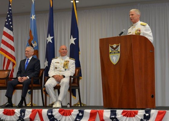 Adm. Craig S. Faller, USN, right, incoming commander of U.S. Southern Command, addresses the audience during the change of command ceremony change of command ceremony held at SOUTHCOM's headquarters in Miami, Fla.