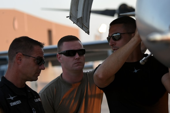 (From left) U.S. Air Force Master Sgt. Chris Schneider, F-16 Viper Demonstration Team (VDT) superintendent, Tech. Sgt. Ryan Hutchinson, F-16 VDT assistant noncommissioned officer in charge, and Tech. Sgt. Stephen Mullins, F-16 VDT avionics specialist, discuss maintenance of an F-16CM Fighting Falcon following a Bahrain International Airshow demonstration flight at Sakhir Airbase, Kingdom of Bahrain, Nov. 14, 2018.