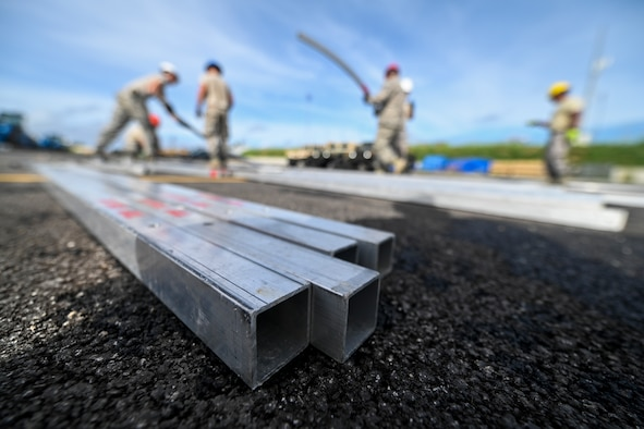 Members of the 254th Rapid Engineer Deployable Heavy Operational Repair Squadron Engineers and the 36th Civil Engineer Squadron build the frame of an  Alaskan Small Shelter System in the village of Koblerville, Saipan, Commonwealth of the Northern Mariana Islands, Nov. 23, 2018.