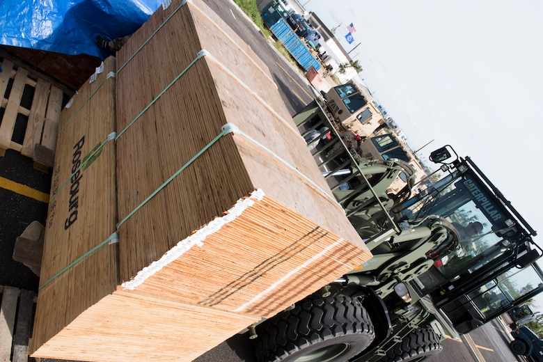 Tech. Sgt. Joe San Nicholas, 254th Rapid Engineer Deployable Heavy Operational Repair Squadron Engineers, moves plywood in preparation for Tropical Storm Man-Yi, Nov. 21, 2018, in the village of Koblerville, Saipan, Commonwealth of the Northern Mariana Islands.
