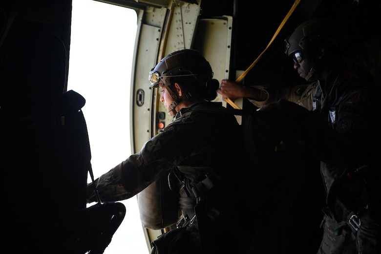 Tech. Sgt. Cassandra Nagy, 93d Air Ground Operations Wing jumpmaster, approaches the door of a HC-130J Combat King II near Moody Air Force Base, Ga. The overall objective of the training was to increase jumpers' skills, knowledge and proficiency in regards to airborne operations. During a static-line jump, the jumper is attached to the aircraft via the 'static-line', which automatically deploys the jumpers' parachute after they've exited the aircraft. (U.S. Air Force photo by 1st Lt. Faith Brodkorb)