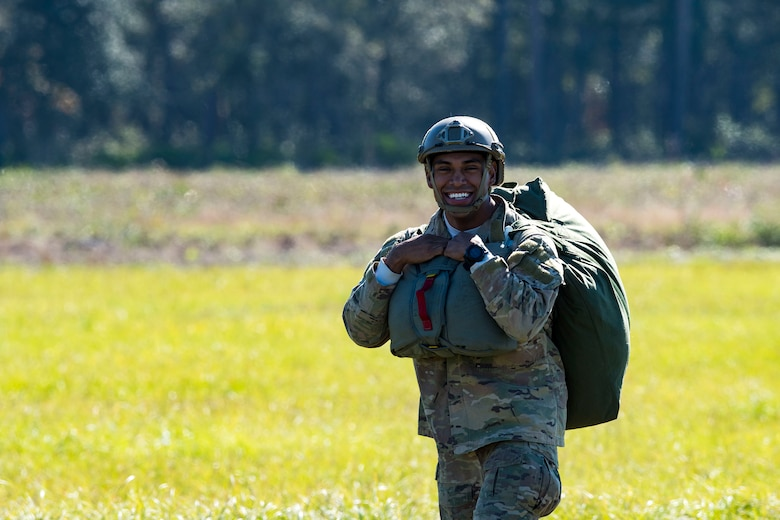 Tech. Sgt. Christopher Zavala, 822d Base Defense Squadron jumpmaster, walks away from a drop zone after packing up his parachute during static-line jump training, Nov. 21, 2018, at Moody Air Force Base, Ga. The overall objective of the training was to increase jumpers' skills, knowledge and proficiency in regards to airborne operations. During a static-line jump, the jumper is attached to the aircraft via the 'static-line', which automatically deploys the jumpers' parachute after they've exited the aircraft. (U.S. Air Force photo by Airman 1st Class Erick Requadt)