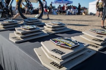 """First, second, and third place competitors recieve trophies after competing in the first annual Telegraph Pass Challenge in Yuma, Ariz., Nov. 3, 2018. The challenge, coordinated by Marine Corps Community Services (MCCS), offered participants the opportunity to compete for first, second, or third place in either a 5 mile run, 5 mile bike route, or both. The course included a """"Blue Mile"""" which is typically the most difficult portion of the racing event being a silent mile. The """"Blue Mile"""" honors and remembers all fallen heroes of the Military, Police, and Fire Department. (U.S. Marine Corps photo by Sgt. Allison Lotz)"""