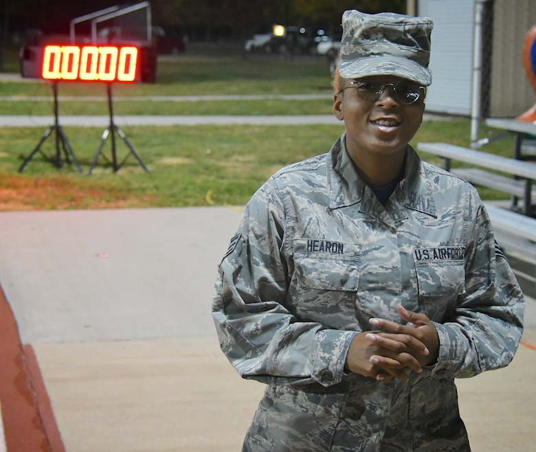 The day starts early before the sun rises as one unit member gets the fitness clock ready.  Explaining the fitness running 1.5 mile test parameters and answering questions from other wing members, Senior Airman Hearon Octavia, far right, prepares to start the timing clock November 4, 2018, at Scott Air Force Base, Ill. She is a member of the 932nd Airlift Wing's Mission Support Group, Services Flight, and she helps get Airmen ready for the various parts of the fitness test each unit training weekend. (U.S. Air Force photo by Lt. Col. Stan Paregien)