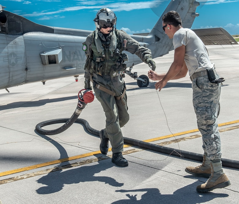 U.S. Air Force Airman 1st Class Brett Heinken, 36th Logistics Readiness Squadron fuels operator prepares to receive a fuel hose after a U.S. Navy Helicopter Sea Combat Squadron 25 member refuels in Saipan, Commonwealth of the Northern Mariana Islands Nov. 5, 2018.