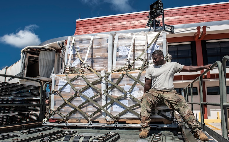 U.S. Air Force Staff Sgt. Deangelo Sidney, 36th Mobility Response Squadron aerial porter, secures a pallet on a Halverson loader in Saipan, Commonwealth of the Northern Mariana Islands (CNMI) Nov. 5, 2018.