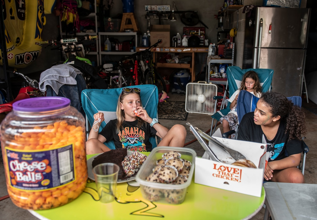 Hayden 8-years-old, London 10-years-old and Olivia 9-years-old wait on customers at their lemonade stand in Yona, Guam Nov. 15, 2018.