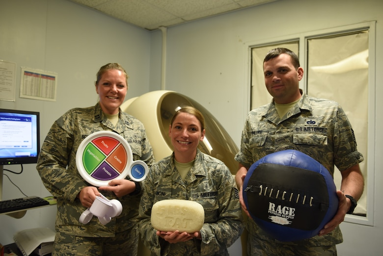 From left, U.S. Air Force Capt. Abigail Schutz, 39th Medical Operations Squadron health promotions element chief, Staff Sgt. Jennifer Mancini, 39th MDOS health promotions technician, and Tech. Sgt. Brian Phillips, 39th MDOS health promotions flight NCO in charge, pose for a photo in front of the Bod Pod at Incirlik Air Base, Turkey, Oct. 2, 2018.