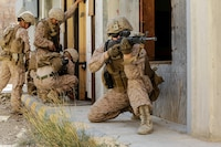 U.S. Marines with Combat Logistic Detachment 34 and 3rd Battalion, 4th Marine Regiment attached to Special Purpose Marine Air-Ground Task Force, Crisis Response-Central Command, prepare to breach a door while executing a demolition range during Exercise Cunning Seahorse November 18, 2018.