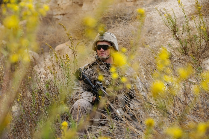 U.S. Marine Corps Lance Cpl. Chase Alumbaugh, a rifle Marine with 3rd Battalion, 4th Marine Regiment, attached to Special Purpose Marine Air-Ground Task Force, Crisis Response-Central Command, provides security during a simulated patrol November 17, 2018.