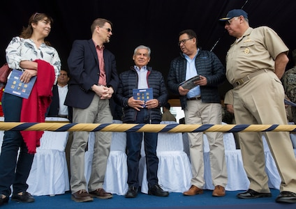 Mark Wells, deputy chief of mission at the U.S. Embassy in Peru,  Peru Prime Minister Cesar Villanueva, Peru Minister of Defense Jose Modesto Huerta Torres and Peru Navy Adm. Fernando Cerdan, commander in chief of the Peruvian Navy, speak about the events taking place during a humanitarian assistance and disaster relief demonstration between U.S. Marines with Special Purpose Marine Air-Ground Task Force - Peru and Peruvian naval forces on Nov. 24, 2018, near Lima, Peru.