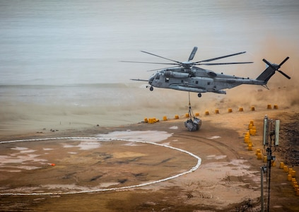 A U.S. Marine Corps CH-53E Super Stallion transports food and water during a humanitarian assistance and disaster relief demonstration between U.S. Marines with Special Purpose Marine Air-Ground Task Force - Peru and Peruvian naval forces Nov. 24, 2018, near Lima, Peru.