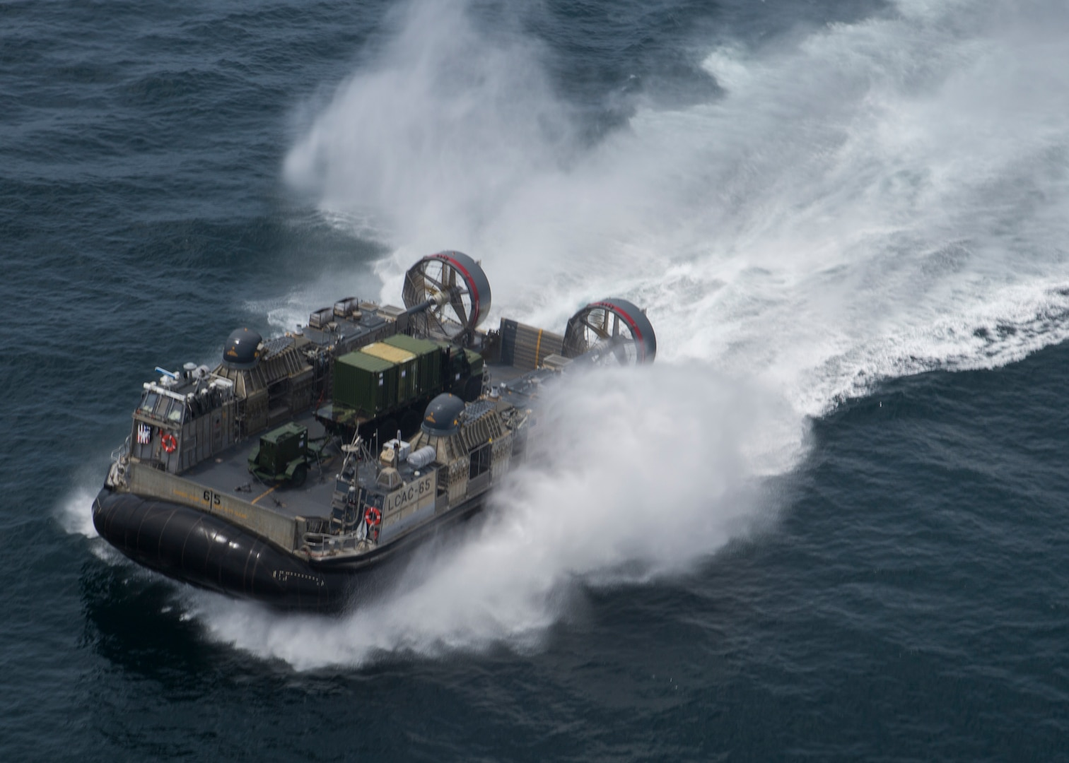 A U.S. Navy Landing Craft, Air Cushion hovercraft transports Marines and equipment with Special Purpose Marine Air-Ground Task Force - Peru during a humanitarian assistance and disaster relief exercise off of the coast of Chorrillos Beach near Lima, Peru, Nov. 24, 2018.