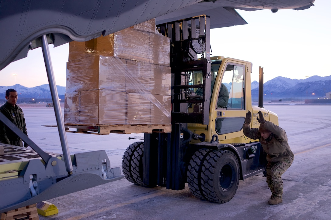 Airmen of 176th Wing load boxes containing prescription drugs onto a 211th Rescue Squadron HC-130J Combat King II Nov. 6, 2018, at Joint Base Elmendorf-Richardson, Alaska, for transport to Spokane, Washington, for incineration. Airmen of 176th Wing, members of the Alaska National Guard Counterdrug Support Program, and special agents of the Drug Enforcement Administration joined forces in the effort of transporting more than 4,000 pounds of prescription drugs turned in during Alaska's biannual prescription drug take back. (U.S. Air National Guard photo by David Bedard/Released)