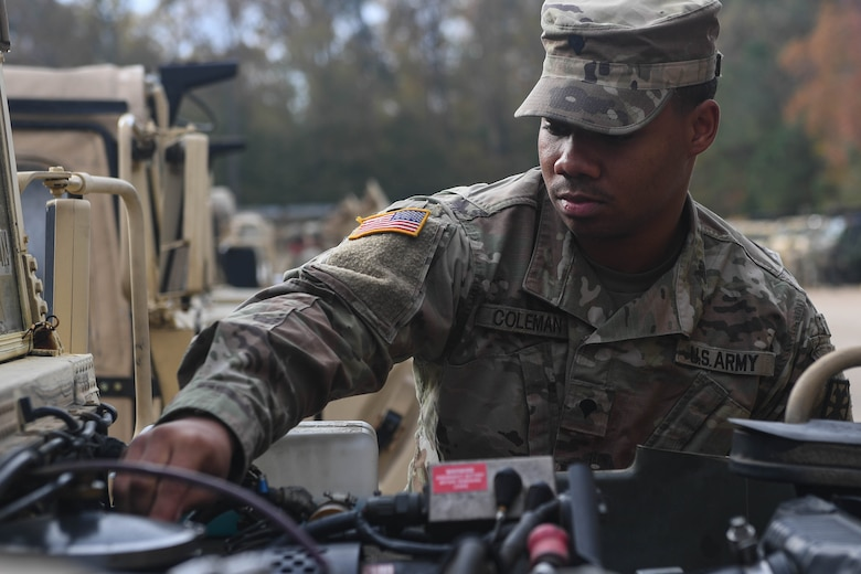 U.S. Army Spc. Takory Coleman, 149th Seaport Operations Company, 10th Transportation Battalion, 7th Trans. Brigade (Expeditionary) transportation management coordinator, checks the oil of a HUMVEE at Joint Base Langley-Eustis, Virginia, Nov. 19, 2018. The vehicle mechanics of the 149th SOC conduct preventative maintenance checks every week to limit and identify any issues the vehicles may have. (U.S. Air Force photo by Senior Airman Derek Seifert)