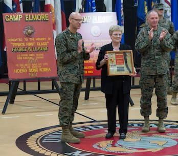 U.S. Marines assigned to U.S. Marine Corps Forces Command and distinguished guests join Deborah Hager during a ceremony where Camp Allen was rededicated as Camp Elmore in honor of Pfc. George W. Elmore, Nov. 27, 2018, at Camp Elmore, Norfolk, Virginia. Hager accepted the honor on behalf of her uncle, Elmore, who gallantly gave his life during combat operations in Hoeng Son, Korea, Feb 26, 1951. (Official U.S. Marine Corps photo by Chris Jones/Released)