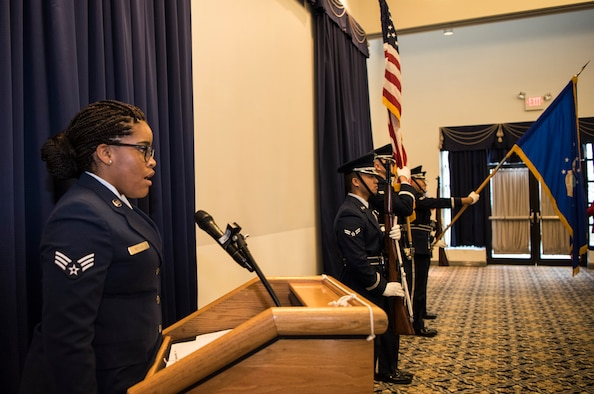 Senior Airman Claire Boyles, 436th Logistics Readiness Squadron, sings the national anthem as the Dover Air Force Base Honor Guard presents the colors at the beginning of the annual State of the Base Nov. 19, 2018, at Dover AFB, Del. The event was hosted by the Central Delaware Chamber of Commerce and provided an opportunity to educate and inform community members and leaders on the economic impact the base has on the surrounding community. (U.S. Air Force photo by Airman 1st Class Zoe M. Wockenfuss)