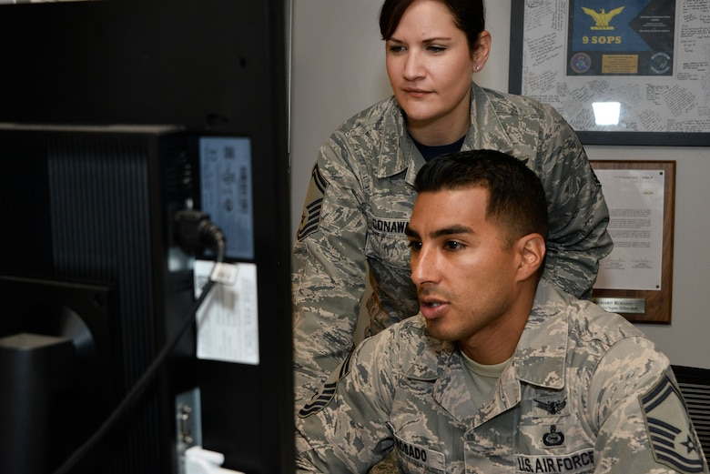 Senior Master Sgt. Kori Conway, and SMSgt Richard Rosado 16th Intelligence Squadron operation superintendent, look over production reports November 9, 2018 at Fort George G. Meade, Maryland. In a recent overlook, Reserve Airmen complete close to 20 percent of the Air Force mission to include flying and special missions. (U.S. Air Force photo by Staff Sgt. Alexandre Montes)