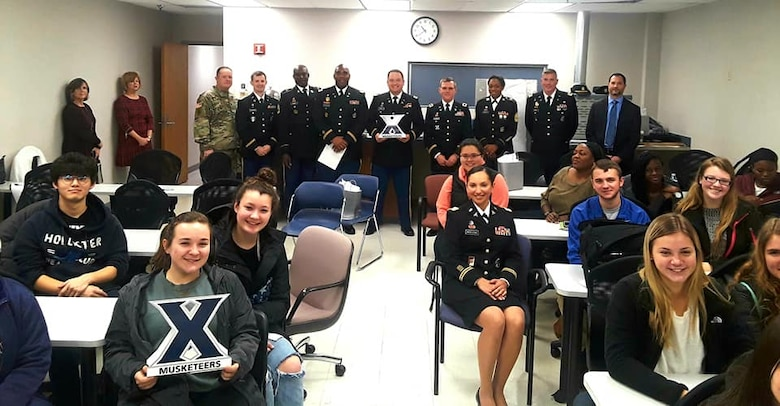 Lt. Col John Ament, 3rd MRB Commander, CSM Syphonia Leggette, and Columbus Recruiting Company talk to students at Xavier University Nursing School in Cincinnati, Ohio on 12 Nov 2018 about Army medical career options.