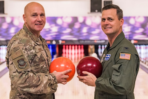Col. Joel Safranek, right, 436th Airlift Wing commander, and Chief Master Sgt. Anthony Green, left, 436th AW command chief, pose for a photo prior to the start of their bowling grudge match Nov. 16, 2018, at the Eagle Lanes on Dover Air Force Base, Del. Safranek challenged Green to a two-out-of-three game grudge match after losing to Green during the 436th AW Leadership Off-Site back in September. Bowling was the close-out event for Dover AFB's 2018 Combined Federal Campaign. (U.S. Air Force photo by Roland Balik)