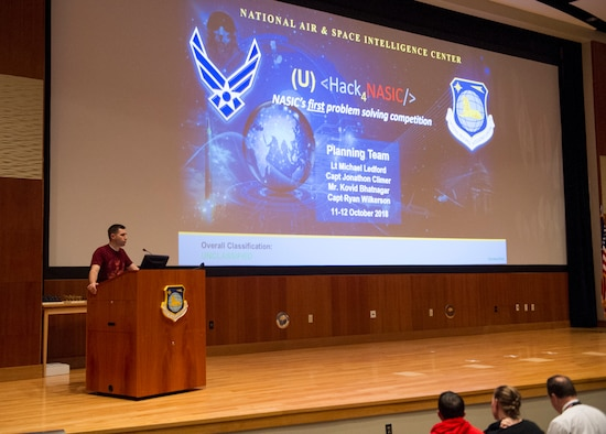 Capt. Jonathan Climer, Integrated C4ISR Analysis Squadron Chief Engineer, introduces the audience to the Hack4NASIC presentations, Oct. 12, 2018. This year was the inaugural year for the event with the hopes of improving NASIC in the years to come. (U.S. Air Force photo by Senior Airman Michael Hunsaker)