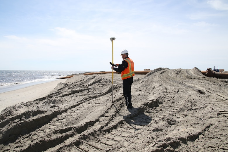 A technician conducts a survey as part of the Manasquan Inlet to Barnegat Inlet Coastal Storm Risk Management project, a joint effort between the U.S. Army Corps of Engineers and the New Jersey Department of Environmental Protection. Weeks Marine is the prime contractor. The project, once fully completed, will cover approximately 14 miles of coastline along the Barnegat Peninsula and will reduce the risk of storm damages for the communities of Point Pleasant Beach, Bay Head, Mantoloking, Brick Township, Toms River Township, Lavallette, Seaside Heights, Seaside Park, and Berkeley Township. More than 11 million cubic yards of sand will be dredged from approved borrow areas and pumped through a series of pipes onto the beaches of the municipalities.