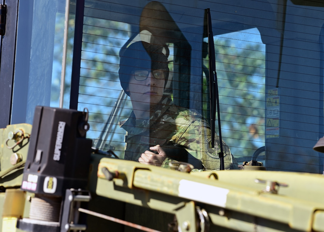 Airman Christian Myers, 1st Special Operations Logistics Readiness Squadron vehicle operator, operates heavy equipment while at Tyndall Air Force Base, Fla., Nov. 27, 2018. Myers is temporarily stationed at Tyndall to aid in the large-scale cleanup and reconstruction efforts that are underway. (U.S. Air Force photo by Senior Airman Isaiah J. Soliz)