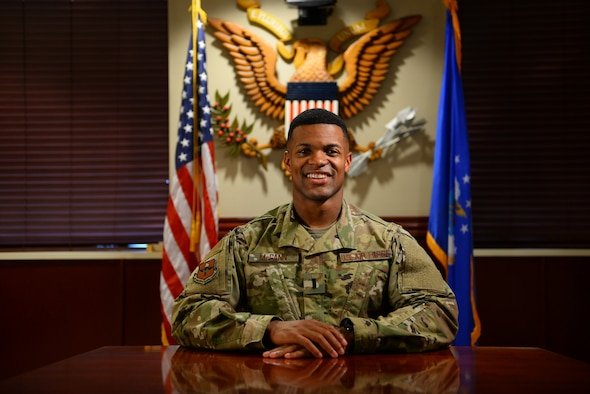 First Lieutenant Mickel McGann, 47th Flying Training Wing Public Affairs deputy chief, poses as a test subject for his Airmen as they set up for a video interview, Nov. 6, 2018, at Laughlin Air Force Base, Texas. One of his primary duties is media operations, which includes overseeing interviews with outside media and working with any type of video communication. (U.S. Air Force photo by Senior Airman Benjamin Valmoja)