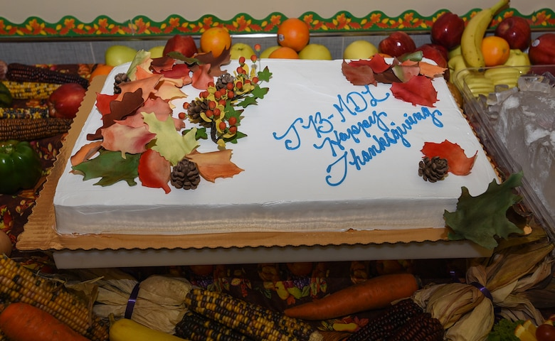 A cake sits on a table during the Thanksgiving dinner on Joint Base McGuire-Dix-Lakehurst, New Jersey, Nov. 22, 2018. The dining facility baked a cake for a dinner that was organized to give military members who were unable to go home a proper Thanksgiving dinner. (U.S. Air Force photo by Airman 1st Class Ariel Owings)