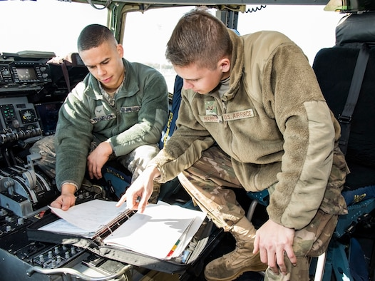 Senior Airman Victor Harris, right, Dedicated Crew Chief, and Airman 1st Class Jason Thompson, left, Assistant DCC, both assigned to the 736th Aircraft Maintenance Squadron, review the aircraft forms of a C-17 Globemaster III Nov. 21, 2018, at Dover Air Force Base, Del. Harris and Thompson were formally appointed as DCC and ADCC of their assigned aircraft during a formal induction ceremony held Nov. 16. (U.S. Air Force photo by Roland Balik)