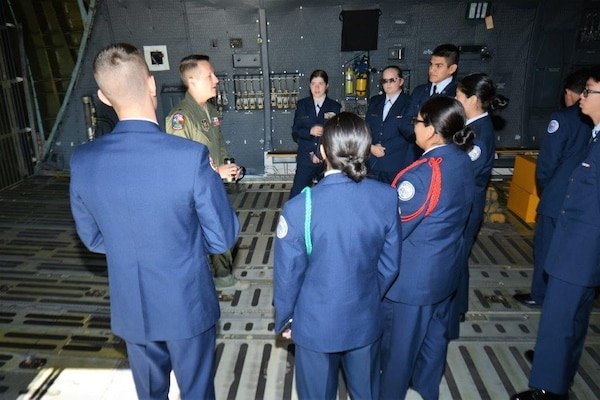 Inside the cargo compartment of the C-5M Super Galaxy, Nov. 16, 2018, Maj. Caleb Rasmussen with the 68th Airlift Squadron, discusses the type of cargo and payload the C-5M Super Galaxy can transport, to Porter High School Air Force Junior Reserve Officers' Training Corps cadets, from Porter, Texas, during a two-day tour of Joint Base San Antonio-Lackland, Texas.