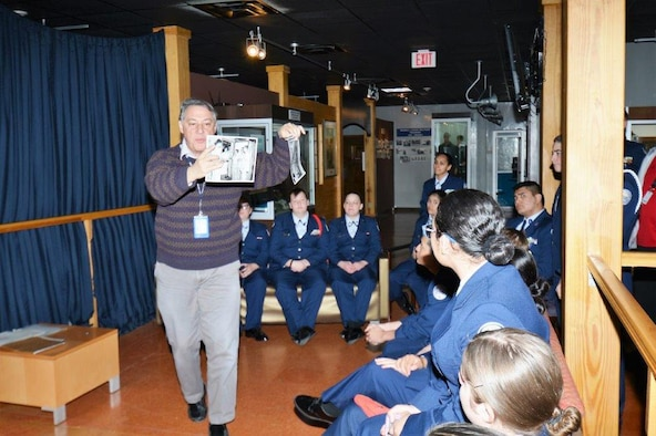 Command Curator Rudy Purificato gives a guided tour with photos at the U.S. Air Force Airman Heritage Museum to Porter High School Air Force Junior Reserve Officers' Training Corps cadets, Nov. 16, 2018 during a two-day tour of Joint Base San Antonio-Lackland.
