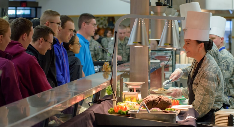 U.S. Air Force Col. Debra Lovette, 81st Training Wing commander, serves Thanksgiving Day lunch to service members inside the Azalea Dining Facility at Keesler Air Force Base, Mississippi, Nov. 22, 2018. It is tradition at Keesler for commanders, first sergeants and superintendents to take time out of their holiday to serve a Thanksgiving meal to technical training and permanent party Airmen. (U.S. Air Force photo by Andre' Askew)