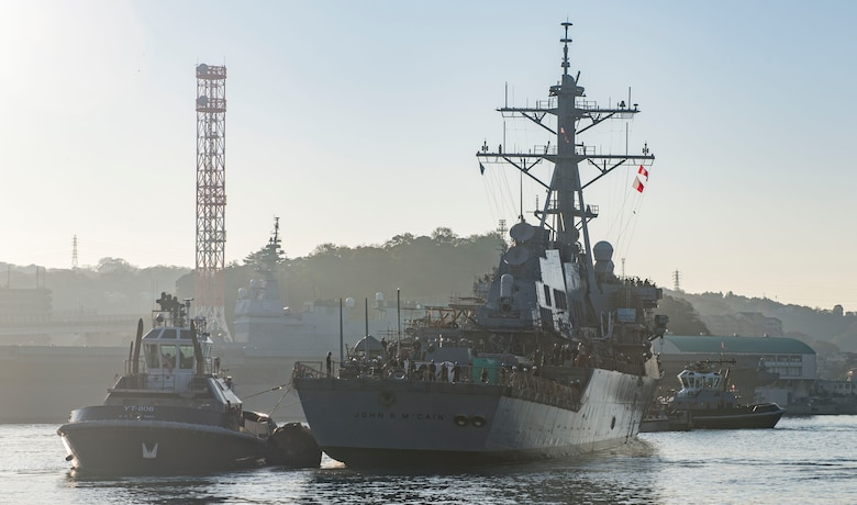 YOKOSUKA, Japan (Nov. 27, 2018) The Arleigh Burke-class guided missile destroyer USS John S. McCain (DDG 56) is pulled towards a pier after departing from a dry dock at Fleet Activities Yokosuka. McCain is departing the dock after an extensive maintenance period in order to sustain the ship's ability to serve as a forward-deployed asset in the U.S. 7th Fleet area of operations.