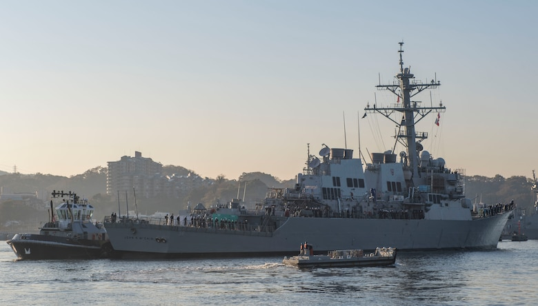 YOKOSUKA, Japan (Nov. 27, 2018) The Arleigh Burke-class guided missile destroyer USS John S. McCain (DDG 56) is pulled towards a pier after departing from a dry dock at Fleet Activities Yokosuka. McCain is departing the dock after an extensive maintenance period in order to sustain the ship's ability to serve as a forward-deployed asset in the U.S. 7th Fleet area of operations. (U.S. Navy Photo by Mass Communication Specialist 2nd Class Jeremy Graham)