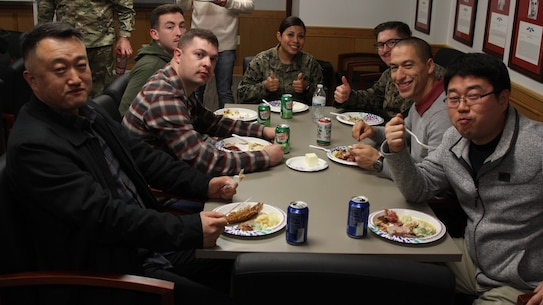 CAMP HUMPHREYS, Republic of Korea - U.S. Marine Corps Forces Korea Marines enjoy their Thanksgiving Meal provided by the spouses of Marines from across the combined joint services here, Nov. 26.  The Marine spouses wanted the Marines to have a nice home cooked meal as a team before departing for the holiday. (Official U.S. Marine Corps photos by Capt. John Parry/Released)
