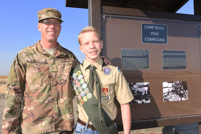 Tech. Sgt. Noah Cheney, an explosive ordinance disposal team leader and Scout Master of Troop 36 in Marysville, poses for a picture with his son Braydon at the POW site on Beale Air Force Base, Calif. Nov 20, 2018.  Braydon organized a renovation of the site for his project that is required a required part of his promotion to Eagle Scout. (Air Force photo by Tech Sgt. Shawn Bryant)